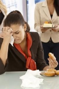 Sad woman eating donut