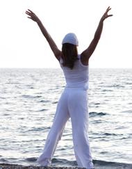 Woman at ocean doing yoga